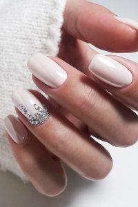 Diamond looking rhinestones on accent nail
