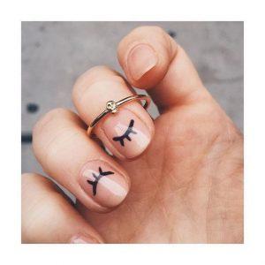 Eyelashes nail art on nude nails