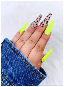 Leopard print on accent nails with neon yellow