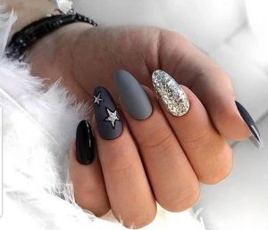 Star stickers on accent nail
