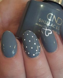 white polka dots on accent nail