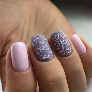 Pink swirly nail art on grey base