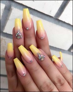 Yellow ombre nails with rhinestones