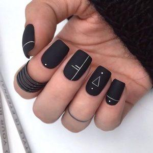 Geometrical designs on dark nail base