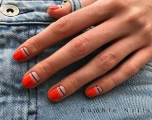 Half nail coloured with a black line to edge the colour