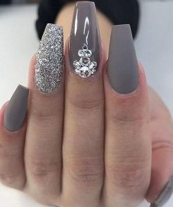 Glitter polish on accent nail and rhinestones on another accent nail