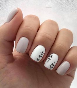 simple leaves nail art on white accent nails