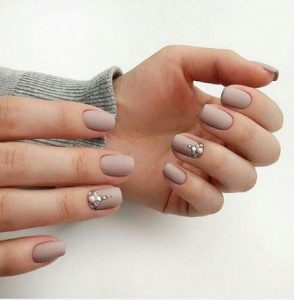 rhinestones on accent nails with matte nails