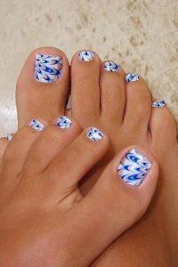 blue abstract toe nail design