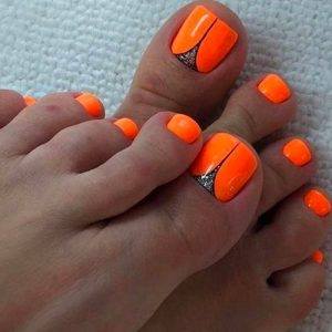 edgy orange neon pedicure