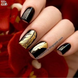 metallic feather on black