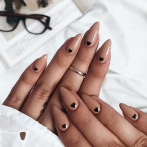 black small hearts on nude
