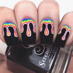 rainbow dripping on black